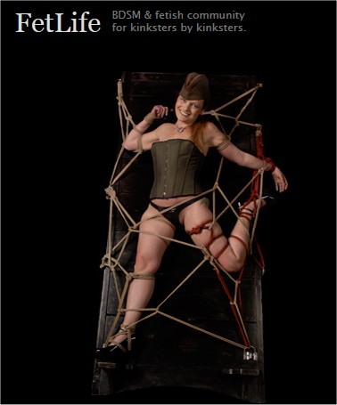 Image of bound, smiling woman from fetlife.com